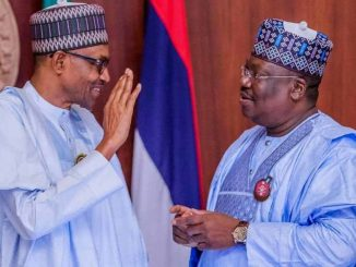 L-R: Buhari and Lawan. (File photo)